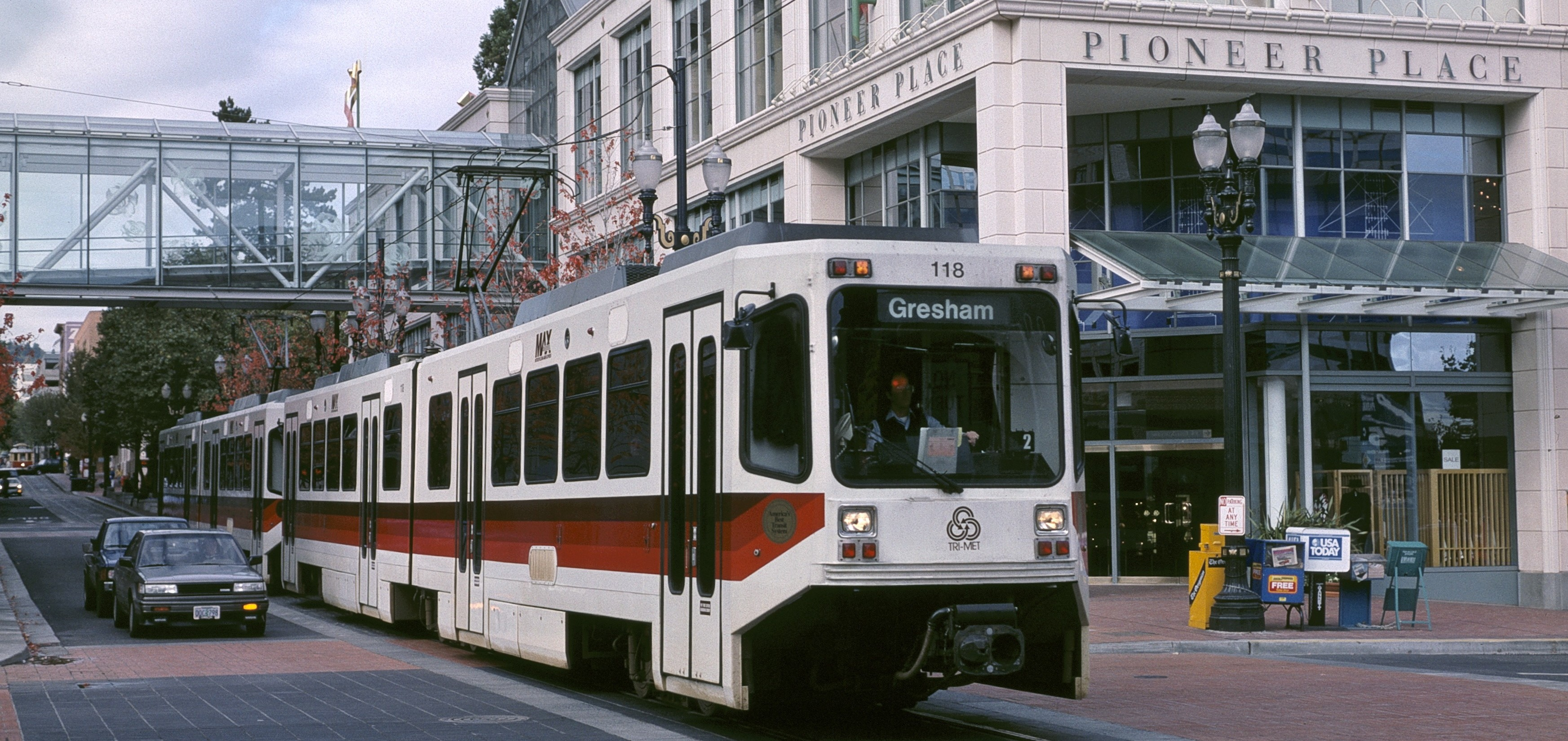 MAX_train_on_Yamhill_St_with_Pioneer_Place_1991_-_Portland_Oregon-e1430466766468